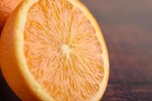 Image macro d'orange mûre avec une petite profondeur de champ photo