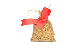 sac avec noeud rouge