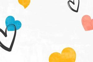 coeurs colorés sur fond blanc pour la carte de voeux de la Saint-Valentin