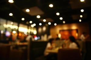 fond de restaurant occupé flou photo