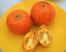 oranges et lingots d'or photo