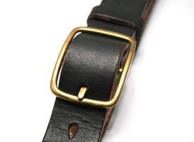 ceinture en cuir noir isolated on white photo