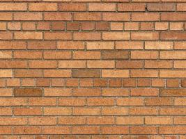 un mur de briques avec des carreaux jaune vif photo