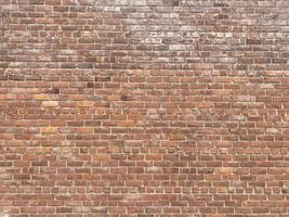 vieux mur avec des briques brunes photo