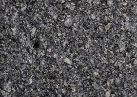 surface et fond de texture de granit gris pierre naturelle. matériau pour la texture de la décoration et la décoration intérieure photo