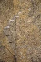 Croix inka de chakana au sanctuaire colossal d'ollantaytambo photo