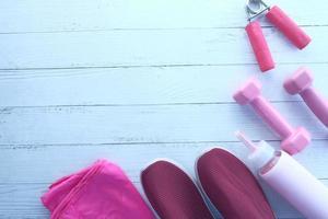 haltères de couleur rose