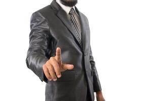 Bel homme d'affaires pointant sur quelque chose d'isolé sur fond blanc photo