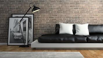 Partie d'un intérieur avec des murs de briques et un rendu 3d de canapé noir