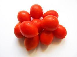 tomates sur fond blanc photo