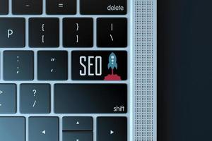 Signe d'optimisation des moteurs de recherche sur le clavier de l'ordinateur portable photo