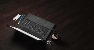 Illustration 3D de bois sombre avec ordinateur portable, stylo, téléphone et fournitures, vue de dessus photo