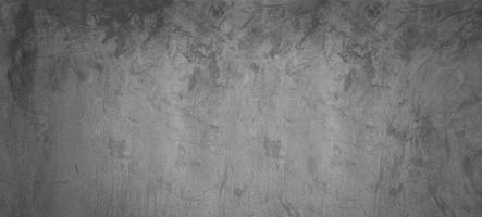 Mur de ciment ou de béton gris et noir pour le fond ou la texture photo