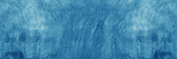Mur de ciment ou de béton bleu pour le fond ou la texture