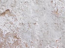 Mur de béton ou de ciment gris pour le fond ou la texture photo