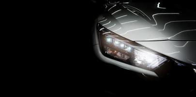 phare de voiture et isolé sur noir photo