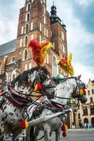 Cracovie, Pologne 2017- entraîneur stylisé sur la place historique de Cracovie photo