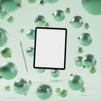 maquette de tablette intelligente avec fond d'ornement de Noël vert photo