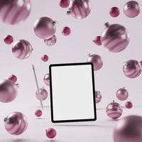 maquette de tablette intelligente avec fond d'ornement de Noël rose photo