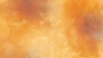 fond de texture de tissu tie dye orange photo