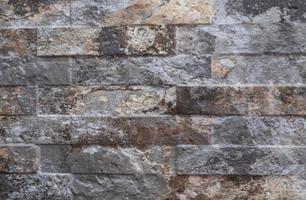 Texture de fond de quartzite décoration de façade naturelle. mur de pierre de granit moderne photo