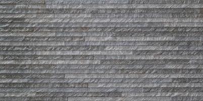 texture de mur rustique formée par de petites briques photo