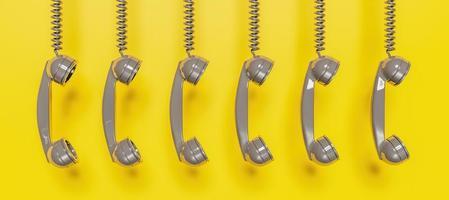 Bannière de casque de téléphone antique gris suspendu à un câble sur fond jaune, rendu 3d photo
