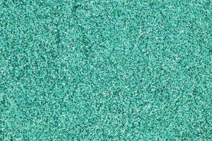 fond de pile de paillettes turquoise coloré photo