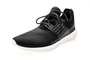 chaussures de sport sur fond blanc photo