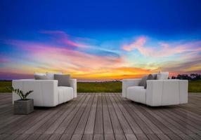 Canapé 3D sur la terrasse au coucher du soleil photo