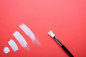 coups de peinture à l'huile sur un papier coloré photo