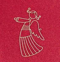 Noël flatlay mise en page jouet en métal ange d'or sur un fond brillant de paillettes rouges photo