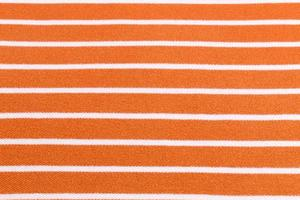 beau fond d'été en tissu orange rayé photo