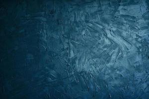 grunge bleu foncé et ciment de texture ou fond concreate photo