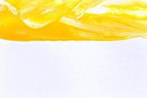 Fond de texture de coup de pinceau de peinture d'aquarelle jaune photo