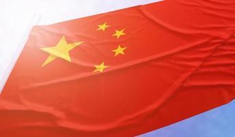 drapeau de la chine sur le ciel bleu photo