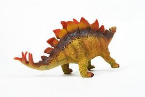 Jouet en caoutchouc de dinosaure isolé sur blanc photo