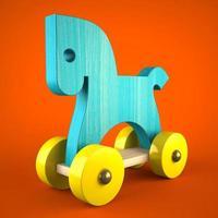 jouet cheval en bois bleu sur fond rouge photo