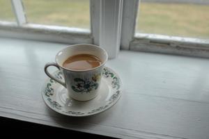 café dans une tasse de thé photo