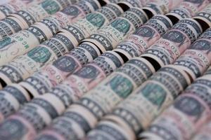 fond d'argent de billet de banque et économiser de l'argent et concept de croissance des affaires photo