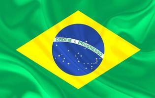 drapeau du brésil sur fond de textile en soie ondulée photo