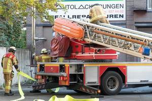 Pompier du service d'incendie de Berlin au travail photo