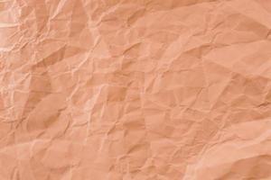 papier orange froissé à la texture douce. fond simple. photo