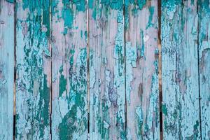 texture de la vieille peinture craquelée sur des planches de bois. photo