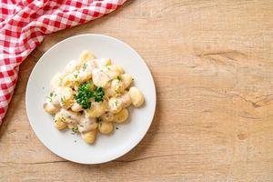 gnocchis à la crème de champignons et fromage photo