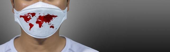 protection contre les virus covid 19 le monde porte un masque pour lutter contre le virus corona. le concept de lutte contre les virus dans le monde photo