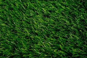 vue de dessus de gazon artificiel vert. revêtement de sol. arrière-plan, espace de copie photo
