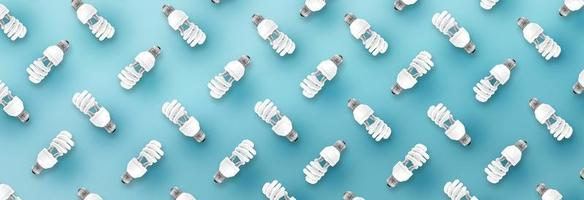 modèle d'ampoule fluorescente sur fond bleu. photo