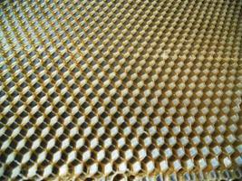 texture d'hexagone de fond, nid d'abeille de cire d'une ruche d'abeille photo