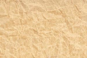 fond de texture de papier kraft froissé. couleur marron clair photo
